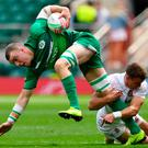 Ireland's Adam Leavy (L) gets tackled by England's Tom Emery (R) during the rugby union sevens pool match between England and Ireland on the first day of the London 2019 World Rugby Sevens Series (Photo by Ben STANSALL / AFP)BEN STANSALL/AFP/Getty Images