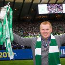 Celtic manager Neil Lennon poses with the trophy