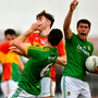 Seán Murphy of Carlow, left, jostles with Meath's Donal Keogan, 6, before getting a red card
