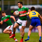 Kevin McLoughlin of Mayo in action against Sean Mullooly of Roscommon