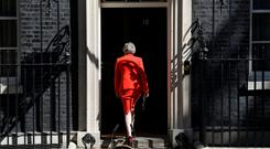 UK Prime Minister Theresa May returns to No 10 Downing Street after delivering her emotional resignation speech on Friday morning. Photo: REUTERS/Toby Melville