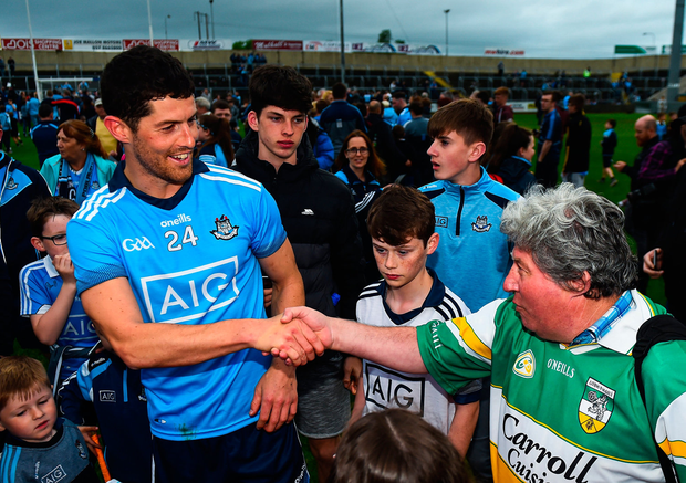 Rory O'Carroll of Dublin is congratulated by legendary Offaly supporter Mick McDonagh