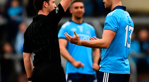 Paul Mannion of Dublin is issued with a red card by referee Jerome Henry