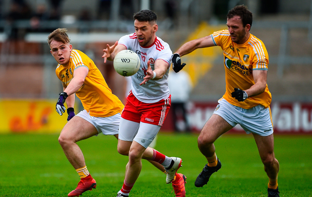 Matthew Donnelly of Tyrone in action against Odhran Eastwood and Patrick Gallagher of Antrim