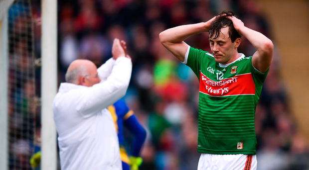 Diarmuid O'Connor of Mayo reacts after a shot on goal went wide