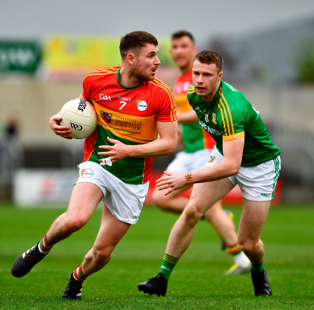 Ciarán Moran of Carlow in action against Barry Dardis of Meath. Photo: Ray McManus/Sportsfile