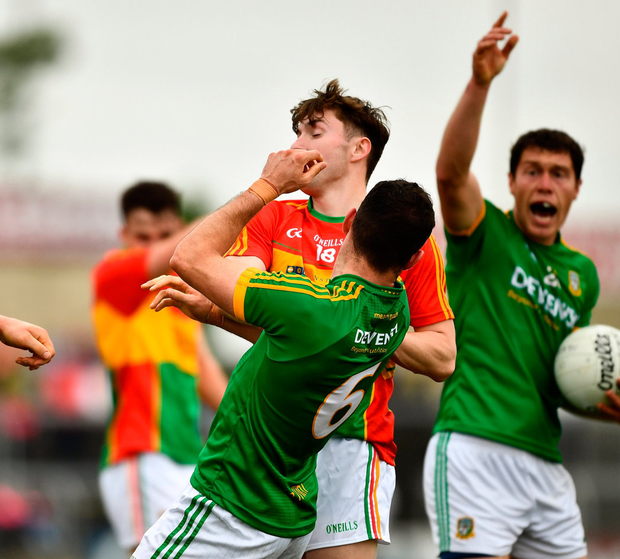 Seán Murphy of Carlow, left, jostles with Meath's Donal Keogan, 6, before getting a red card. Photo: Ray McManus/Sportsfile