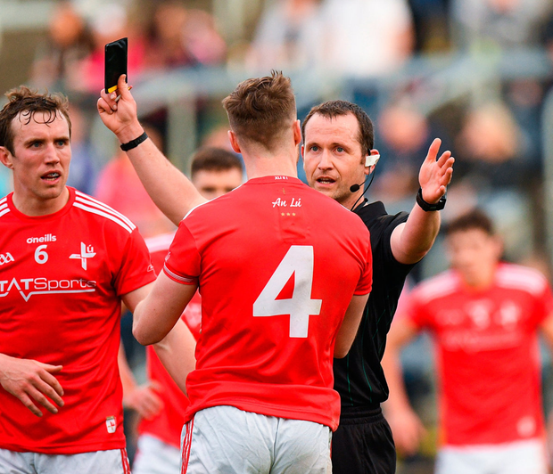 ames Craven of Louth is shown a black card by referee Jerome Henry. Photo: Eóin Noonan/Sportsfile