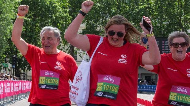 Jim Carter (left) runs a mile alongside disabled people for Special Olympics (Ken Hanrahan-Smith/PA)