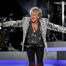 Rod Stewart performs on stage