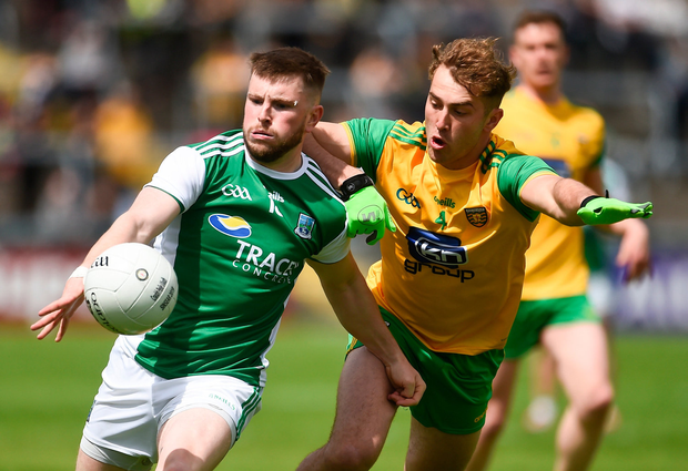 Daniel Teague of Fermanagh in action against Stephen McMenamin of Donegal during the Ulster GAA Football Senior Championship Quarter-Final at Brewster Park in Enniskillen, Fermanagh. Photo by Oliver McVeigh/Sportsfile