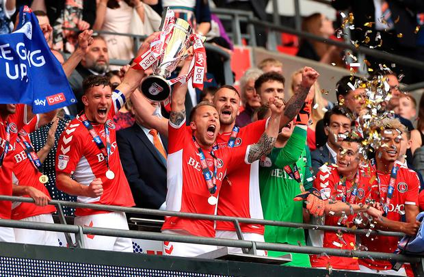 Charlton players lift the Sky Bet League One Play-off Final Trophy after the Sky Bet League One Play-off final at Wembley Stadium. Photo credit Mike Egerton/PA Wire.