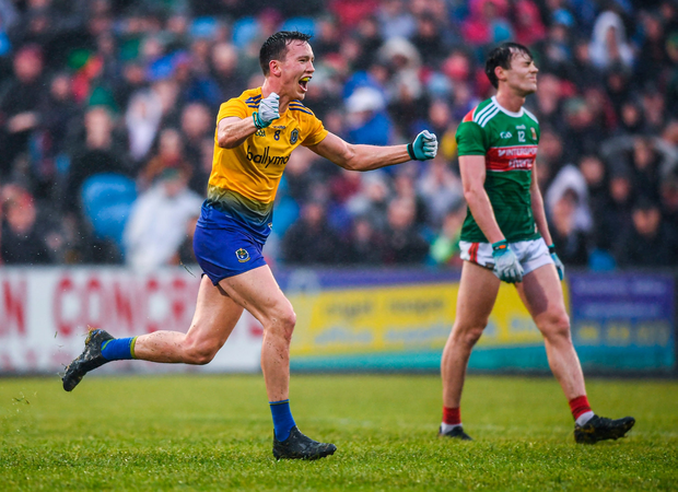 Ecstasy and Agony: Tadgh O'Rourke of Roscommon celebrates at the final whistle beside a disappointed Diarmuid O'Connor. Photo by Stephen McCarthy/Sportsfile