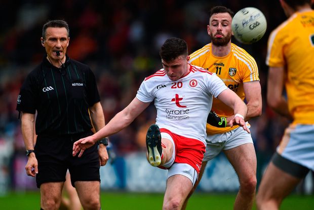 Tyrone's Connor McAliskey gets his kick away under pressure from Matthew Fitzpatrick. Photo by Oliver McVeigh/Sportsfile