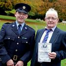 Garda David Hearne, receiving a certificate of bravery for saving a drowning man, with his ex-garda father Declan who in 1958 also received a certificate of bravery. Photo: Maxwells
