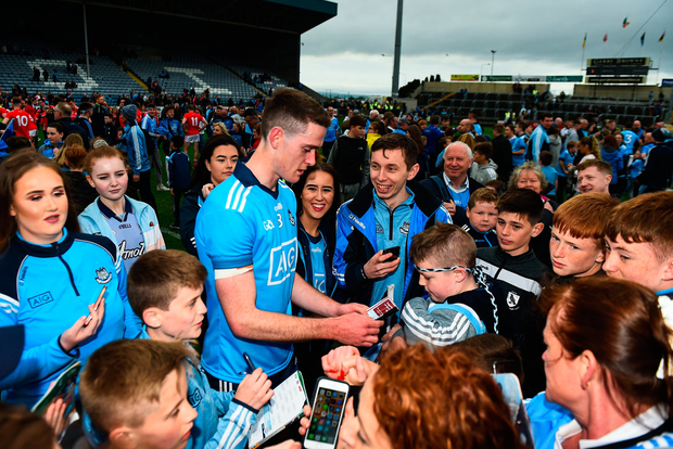 Brian Fenton signs autographs for supporters after Dublin's victory in Portlaoise on Saturday night. Photo by Eóin Noonan/Sportsfile