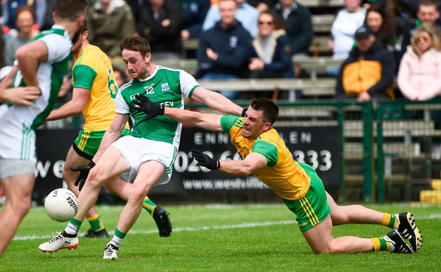Donegal's Paddy McGrath puts the pressure on Fermanagh's Ciaran Corrigan. Photo by Oliver McVeigh/Sportsfile