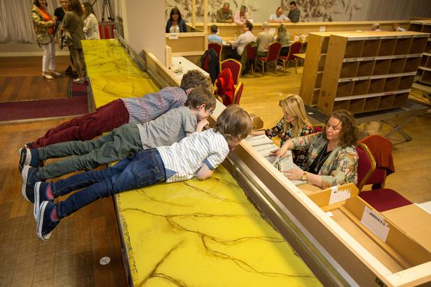 Brothers Harry (10), Hugh (6) and Rory (5) Munnelly keep an eye on their dad's Cllr Jarlath Munnelly votes count at the Castlebar count centre Pic:Mark Condren