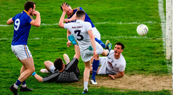 Longford's David McGivney looks on as his team-mate Michael Quinn, hidden by Kildare full-back David Hyland, shoots past goalkeeper Mark Donnellan and Eoin Doyle (No 6) to score a goal during extra-time. Photo by Ray McManus/Sportsfile