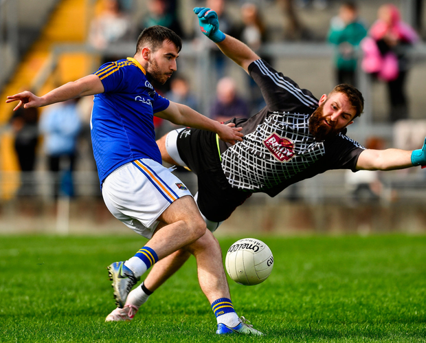 Mark Hughes of Longford beats the Kildare goalkeeper Mark Donnellan to score a goal in the 54th minute. Photo by Ray McManus/Sportsfile