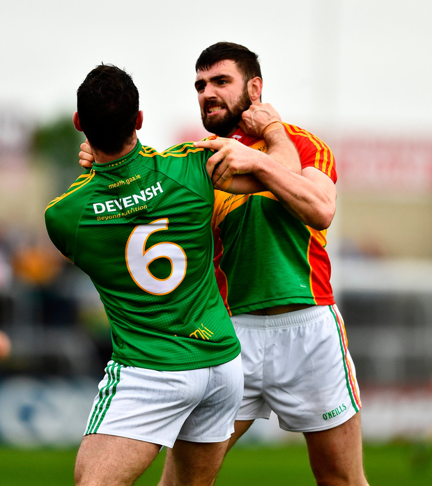 Carlow's Seán Murphy (R) jostles with Donal Keogan before getting his red card. Photo by Ray McManus/Sportsfile