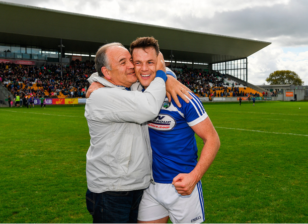 That's my boy: John O'Loughlin of Laois is congratulated by his father Oliver after the game. Photo by Ray McManus/Sportsfile