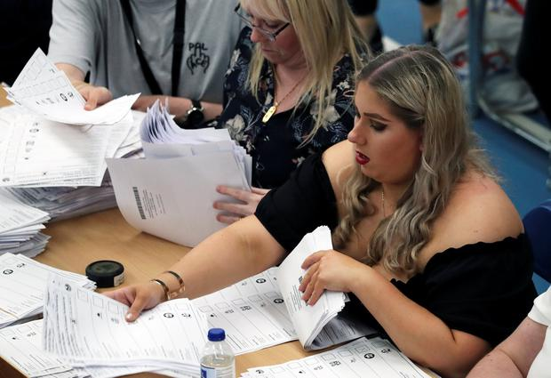 Totting up: Ballots are tallied at a counting centre for the European parliamentary election in Sunderland. Photo: REUTERS/Scott Heppell