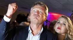 Germany's anti-immigration party Alternative for Germany (AfD) leader Joerg Meuthen welcomes first exit polls in Berlin. Photo: REUTERS/Axel Schmidt