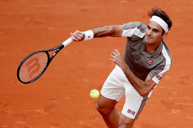 Roger Federer in action during his first round match against Italy's Lorenzo Sonego. Photo: REUTERS/Christian Hartmann
