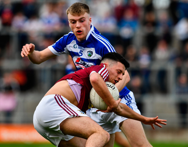 Ronan O Toole of Westmeath in action against Seán O'Flynn of Laois. Photo by Ray McManus/Sportsfile