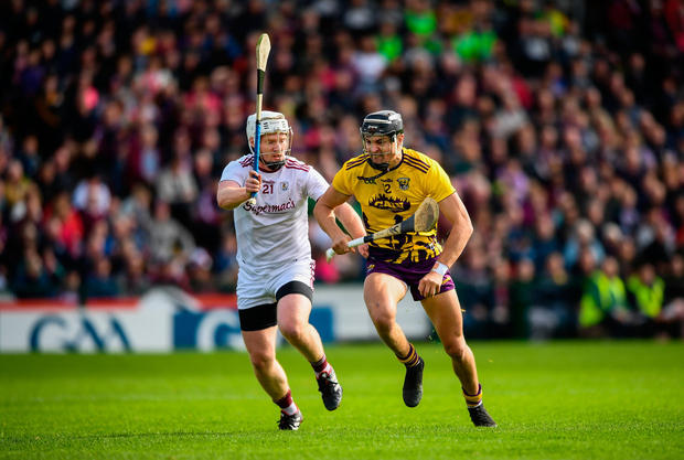Jack O'Connor of Wexford in action against John Hanbury of Galway. Photo by Stephen McCarthy/Sportsfile
