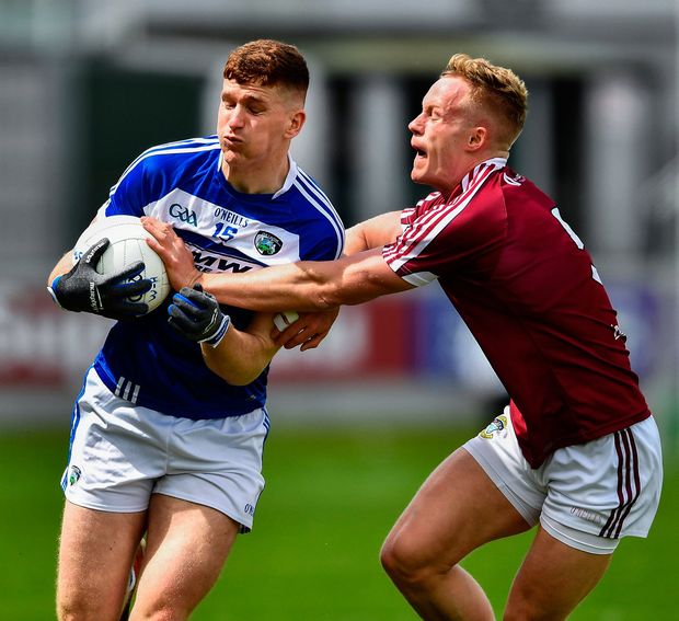 GOOD TACKLE: Laois' Evan O'Carroll holds off Killian Daly of Westmeath during their Leinster SFC quarter-final. Photo by Ray McManus/Sportsfile