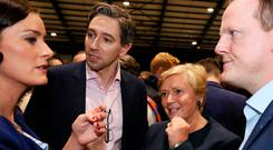 Election campaign: Fine Gael candidate Frances Fitzgerald with party colleagues Simon Harris, Kate O'Connell and Alan Farrell at the count centre in the RDS, Dublin, yesterday. Photo: PA