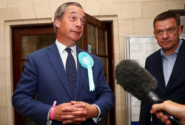 Brexit Party leader Nigel Farage speaks to the media outside the counting centre for the European Parliamentary election in Southampton, England. Photo: REUTERS/Hannah McKay