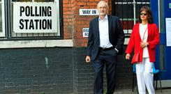 Labour leader Jeremy Corbyn and his wife Laura Alvarez outside the polling station in Islington, north London, where they voted in the European Parliament elections Photo: Stefan Rousseau/PA Wire