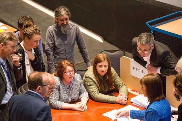 Sinn Féin TD Pearse Doherty, Green Party candidat Saoirse McHugh and MEP Luke Ming Flanagan monitor the adjudication of spoiled votes at the Castlebar count centre for the Midlands-Northwest. Photo: Mark Condren