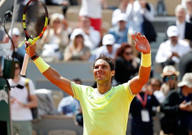 Tennis - French Open - Roland Garros, Paris, France - May 27, 2019. Spain's Rafael Nadal celebrates after winning his first round match against Germany's Yannick Hanfmann. REUTERS/Vincent Kessler