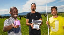Big step forward: Waterford IT's John Byabazaire, Dr Eyal Misha and Mohit Taneja with the 'MELD' technology they have developed to detect lameness in cows. Photo: Patrick Browne