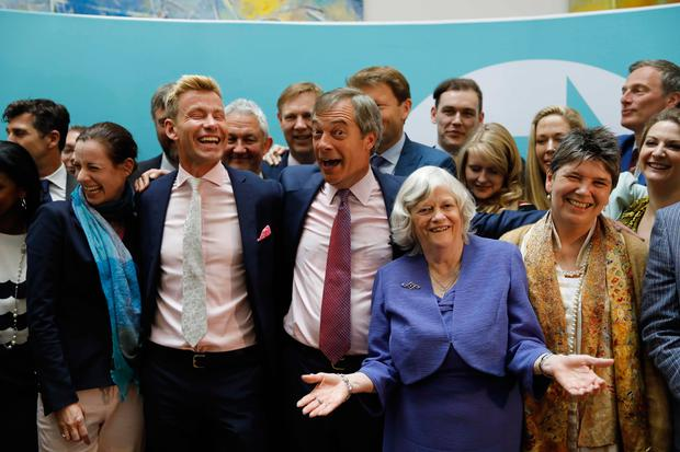 Celebration: Brexit Party founder and leader Nigel Farage is joined by his victorious MEPs in London. Photo: AFP/Getty
