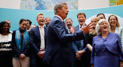 Standing with his fellow MEPs, Brexit Party leader Nigel Farage (C) speaks to members of the media at a post-European Parliament election press call . Photo: AFP/Getty Images