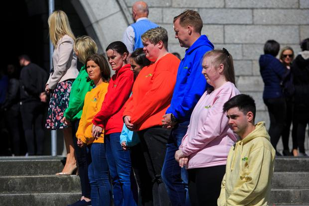 Guard of honour: People wore Barretstown hoodies during a memorial service celebrating the life of Seamus Lawless. Photo: Gareth Chaney, Collins