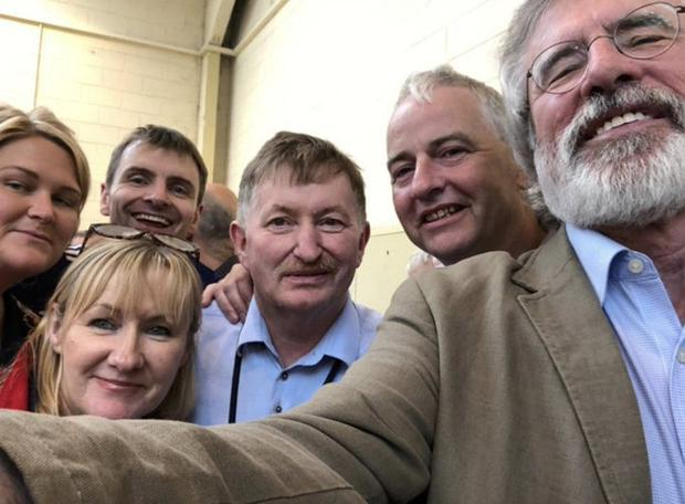 Celebrating: Gerry Adams (right) posted this image on Twitter of himself with Pearse McGeough (centre)