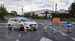 Scene: Gardaí sealed off the road around the scene of the accident at Scrubb, Killeigh, near Tullamore. Photo: Arthur Carron