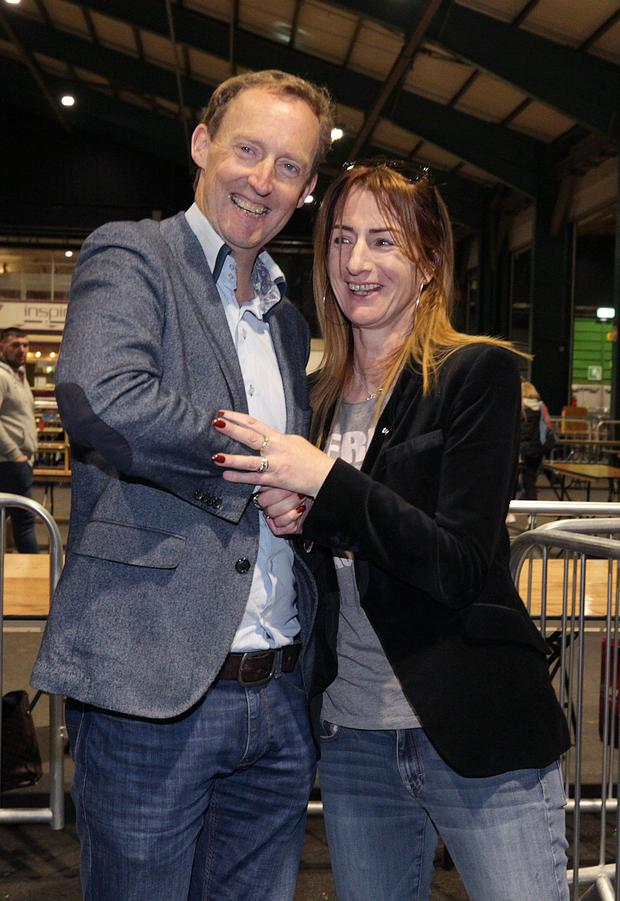 Independents4Change candidate, Clare Daly, TD, and Fianna Fail candidate, Barry Andrews smile after they were both elected in the Dublin European Elections. Picture credit: Damien Eagers / INM