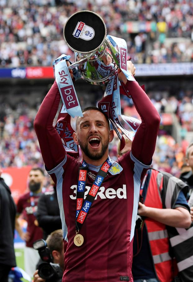 Aston Villa's Conor Hourihane celebrates with the trophy after winning the Championship play-off fina. Photo: Reuters/Tony O'Brien