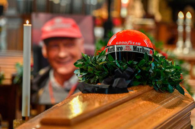 The helmet of the former Formula One driver sits on top of his coffin. Photo: Getty Images