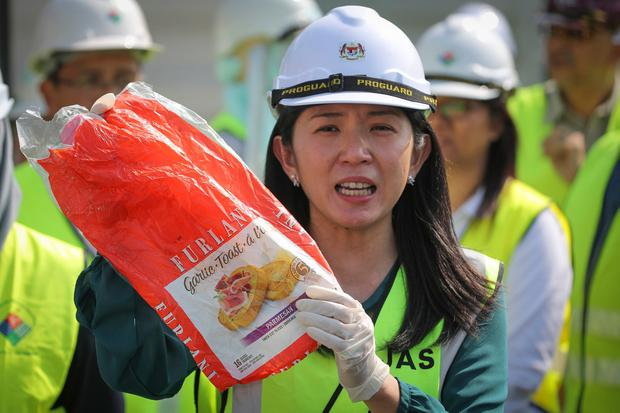 Malaysia's Environment Minister Yeo Bee Yin shows plastic waste from a shipment that had arrived from abroad. AP Photo/Vincent Thian