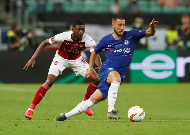 Chelsea's Eden Hazard in action with Arsenal's Ainsley Maitland-Niles. Photo: Reuters/Maxim Shemetov