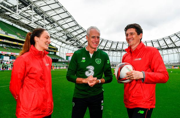 Ready for action: Mick McCarthy with current women's international Megan Campbell and ex-Ireland midfielder Keith Andrews at the Aviva Stadium yesterday. Photo by Sam Barnes/Sportsfile