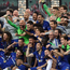 Chelsea players lift the Europa League trophy after a thumping win against Arsenal in Baku